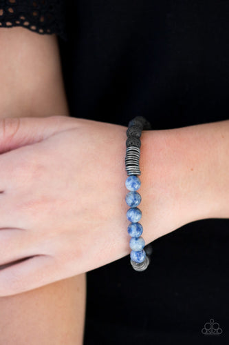 Essential Oil Alert!!!  A collection of metallic accents, refreshing blue stones, and black lava stones are threaded along a stretchy band for a seasonal look.  Sold as one individual bracelet.  Always nickel and lead free.