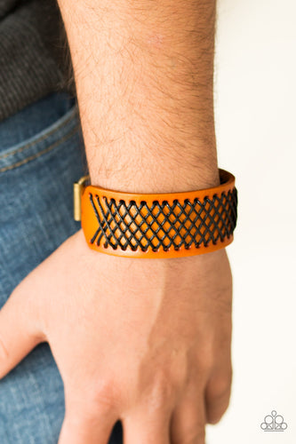 Shiny black thread is stitched across the front of a brown leather band. The crisscrossing threads create a tactile pattern around the wrist. Features an adjustable buckle closure.  Sold as one individual bracelet.  Always nickel and lead free.