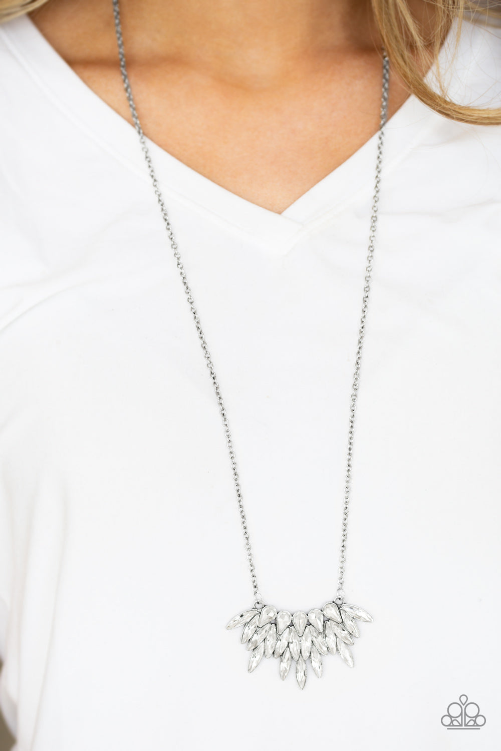 Featuring regal teardrop and marquise style cuts, glittery white rhinestones fan from the bottom of a lengthened silver chain for a dramatic look. Features an adjustable clasp closure.  Sold as one individual necklace. Includes one pair of matching earrings.  Always nickel and lead free.