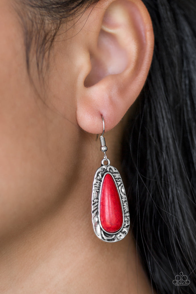 Chiseled into a tranquil teardrop, a fiery red stone is pressed into the center of a shimmery silver frame radiating with hammered details for an artisan inspired look. Earring attaches to a standard fishhook fitting.  Sold as one pair of earrings.  Always nickel and lead free.