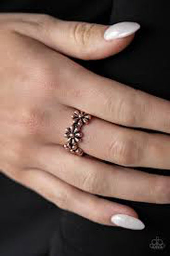 A row of dainty copper daisies connect across the finger, coalescing into a whimsical band. Features a dainty stretchy band for a flexible fit.  Sold as one individual ring.   Always nickel and lead free.