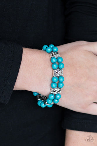 Double rows of vibrant blue beads and floral silver frames are threaded along stretchy bands around the wrist for a whimsical flair.  Sold as one individual bracelet. Always nickel and lead free.