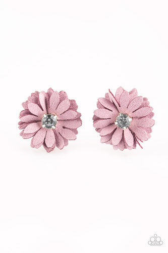 Layers of purple suede petals stack into a pair of billowy blossoms. Glassy white rhinestones adorn the centers, adding refined shimmer to the spring inspired flowers. Each flower features a standard hair clip on the back.  Sold as one pair of hair clips.   Always nickel and lead free.
