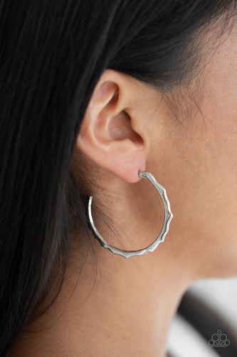 Brushed in a high-sheen finish, a jagged silver hoop curls around the ear for an edgy look. Earring attaches to a standard post fitting. Hoop measures 1 1/2