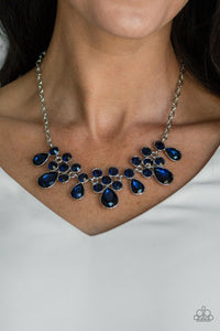 A collection of round and teardrop blue rhinestones coalesce into dazzling frames as they link below the collar, creating a glamorous fringe. Features an adjustable clasp closure.  Sold as one individual necklace. Includes one pair of matching earrings.  Always nickel and lead free.