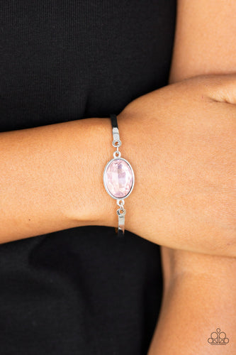 Arcing silver bars connect to a faceted pink gem centerpiece, creating a dainty cuff-like bracelet around the wrist. Features an adjustable clasp closure.  Sold as one individual bracelet. Always nickel and lead free.