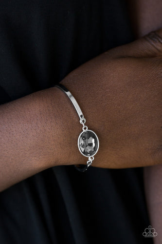 Arcing silver bars connect to a faceted smoky gem centerpiece, creating a dainty cuff-like bracelet around the wrist. Features an adjustable clasp closure.  Sold as one individual bracelet. Always nickel and lead free.
