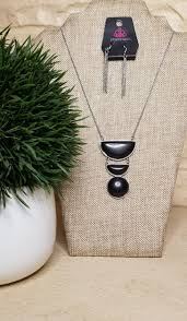 Chiseled into three tiers, the black geometrical stone pendant swings from the bottom of a lengthened silver chain for a refined flair. Features an adjustable clasp closure.  Sold as one individual necklace. Includes one pair of matching earrings  Always nickel and lead free