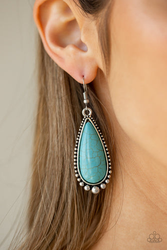 Chiseled into a tranquil teardrop, a refreshing turquoise stone is pressed into a studded silver frame for a seasonal flair. Earring attaches to a standard fishhook fitting.  Sold as one pair of earrings. Always nickel and lead free.