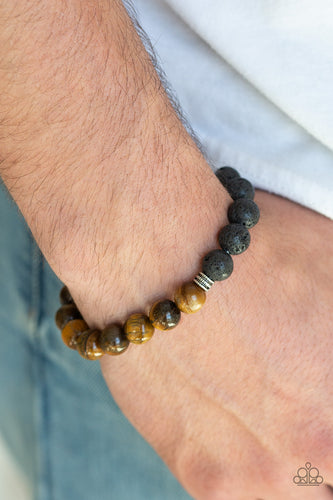 Essential Oil Alert!!  A collection of dainty silver accents, black lava rock beads, and earthy tiger's eye stones are threaded along a stretchy band around the wrist for a seasonal style.  Sold as one individual bracelet.  Always nickel and lead free.