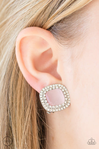 A dewy pink moonstone is pressed into a white rhinestone encrusted frame for a glamorous look. Earring attaches to a standard clip-on fitting.  Sold as one pair of clip-on earrings.  Always nickel and lead free.