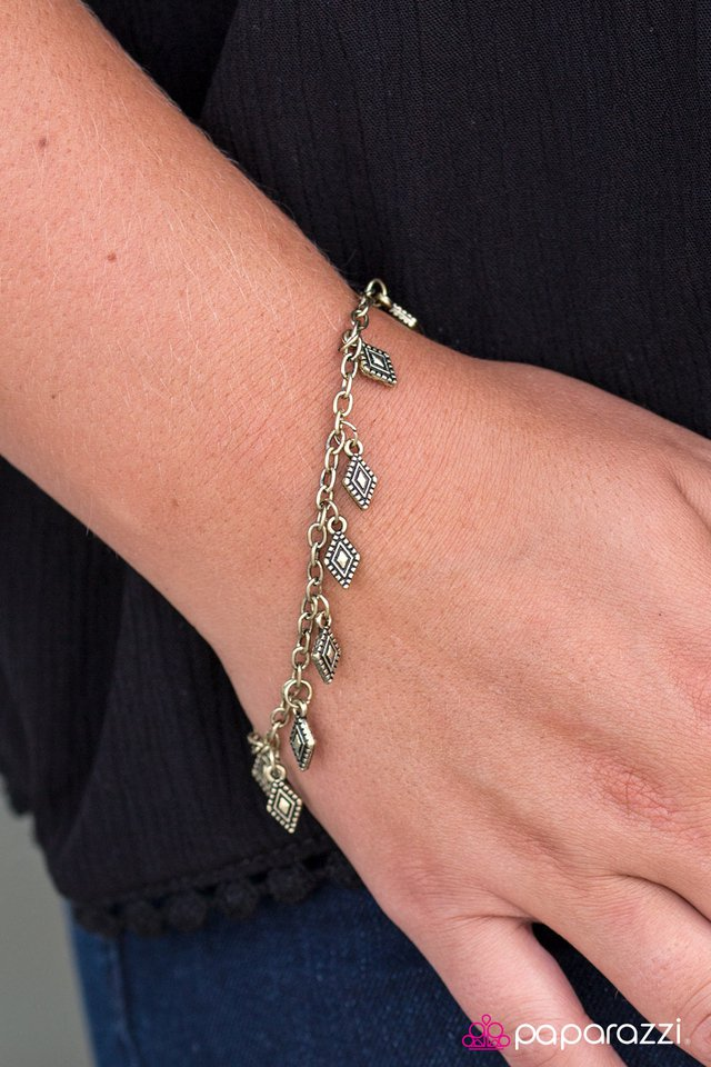 Brass diamond-shaped charms swing from the wrist in a whimsical fashion. Features an adjustable clasp closure.  Sold as one individual bracelet.  Always nickel and lead free.