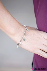 Silver diamond-shaped charms swing from the wrist in a whimsical fashion. Features an adjustable clasp closure.  Sold as one individual bracelet.  Always nickel and lead free.