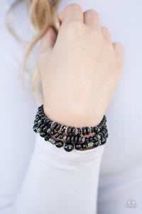 Varying in shape and shimmer, shiny black beads are threaded along three elastic stretchy bands. Infused with dainty silver accents, the colorful bracelets stack across the wrist for a refined look.  Sold as one set of three bracelets.  Always nickel and lead free.