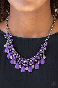Glistening gunmetal and vivacious purple teardrops drip from the bottom of interlocking gunmetal chains. Matching gunmetal and purple beads trickle down the rows of chain, creating a bold fringe below the collar. Features an adjustable clasp closure.  Sold as one individual necklace. Includes one pair of matching earrings.  Always nickel and lead free.