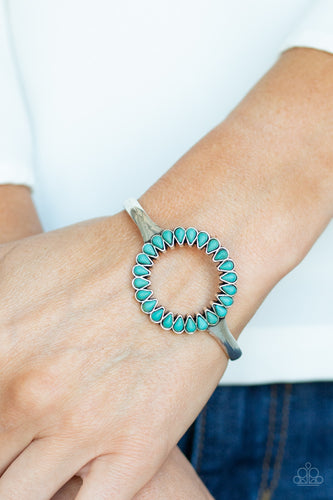 Chiseled into tranquil teardrops, earthy turquoise stones spin around the center of an antiqued silver cuff for a seasonal look.  Sold as one individual bracelet.  Always nickel and lead free.