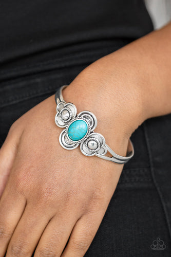 A refreshing turquoise stone is pressed into the center of a dainty silver cuff radiating with textured silver frames for a seasonal look.  Sold as one individual bracelet.   Always nickel and lead free.