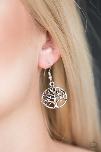Brushed in an antiqued shimmer, a glistening tree branches out across a dainty silver frame for a whimsical look. Earring attaches to a standard fishhook fitting.  Tree of Life  Sold as one pair of earrings.  Always nickel and lead free.