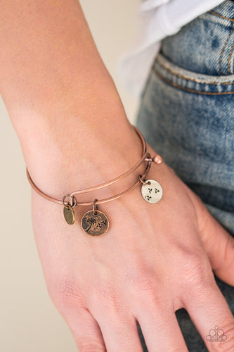 Stamped in dandelion patterns, glistening brass, copper, and silver charms featuring floral patterns slide along a sleek copper bar fitting for a whimsical look. Features a toggle closure.  Sold as one individual bracelet.  Always nickel and lead free.