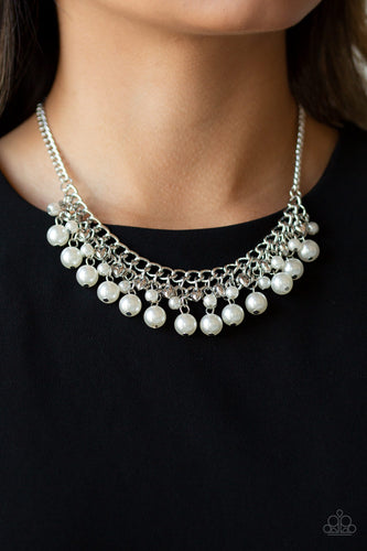 Tiers of dainty silver heart charms, dainty white pearls, and larger white pearls cascade below the collar, creating a flirtatiously layered fringe. Features an adjustable clasp closure.  Sold as one individual necklace. Includes one pair of matching earrings. Always nickel and lead free.