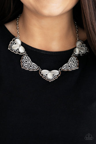 Filled with lacy-like patterns, filigree filled silver frames connect below the collar. Glowing white teardrop moonstones alternate along the airy frames, adding a refreshing hint of color to the whimsical fringe. Features an adjustable clasp closure.  Sold as one individual necklace. Includes one pair of matching earrings. Always nickel and lead free.