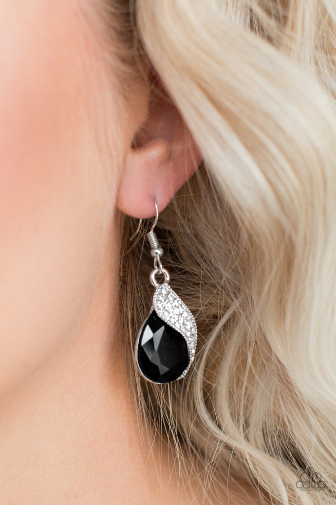 Encrusted in glittery white rhinestones, a shimmery silver ribbon wraps around a faceted black teardrop gem for a timeless look. Earring attaches to a standard fishhook fitting.  Sold as one pair of earrings.  Always nickel and lead free.
