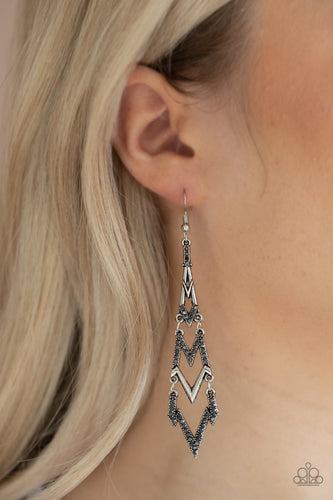 Featuring edgy zigzag shapes, plain silver and hematite rhinestone encrusted bars stack into an electrifying lure. Earring attaches to a standard fishhook fitting.  Sold as one pair of earrings.  Always nickel and lead free.