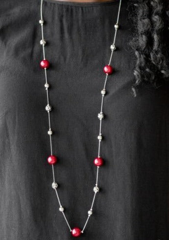 Infused with pearly red accents, classic silver and delicately hammered silver beads trickle along an elegantly elongated silver chain for a refined look. Features an adjustable clasp closure.  Sold as one individual necklace. Includes one pair of matching earrings.  Always nickel and lead free.