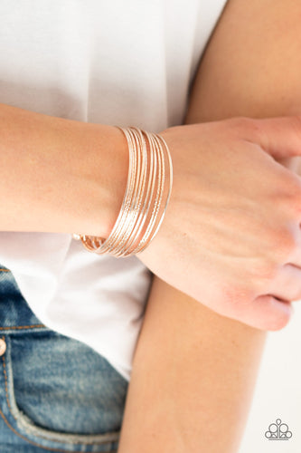 Attached to two rose gold rods, smooth and textured rose gold bars curl around the wrist, creating the illusion of stacked bangles. Sold as one individual bracelet.  Complete the look with other pieces from the collection  Always nickel and lead free.