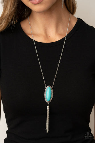 An oval turquoise stone is pressed into a glistening silver frame stamped in antiqued tribal inspired patterns. A shimmery silver chain tassel swings from the bottom of the earthy pendant for a whimsical finish. Features an adjustable clasp closure.  Sold as one individual necklace. Includes one pair of matching earrings.  Always nickel and lead free.