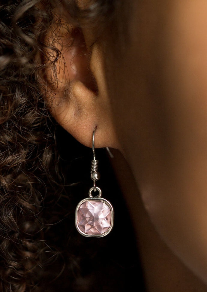 Featuring sparkling faceted surfaces, a glittery pink square gem is pressed into the center of a sleek silver frame, creating a glamorous lure. Earring attaches to a standard fishhook fitting.  Sold as one pair of earrings.   Always nickel and lead free.