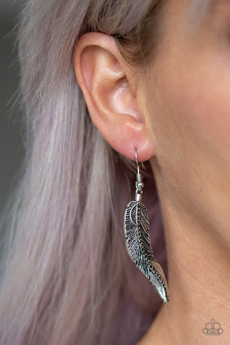 Etched in lifelike textures, the spine of a silver feather is encrusted in glittery hematite rhinestones for an edgy look. Earring attaches to a standard fishhook fitting.  Sold as one pair of earrings. Always nickel and lead free.