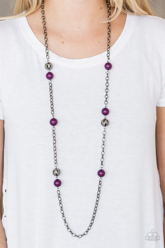Polished purple beads and ornate gunmetal beads trickle along a bold gunmetal chain, creating a colorfully industrial look across the chest. Features an adjustable clasp closure.  Sold as one individual necklace. Includes one pair of matching earrings.  Always nickel and lead free!
