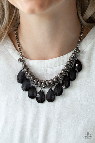 A row of glistening gunmetal beads gives way to glassy black teardrops, creating a bold tone on tone fringe below the collar. Features an adjustable clasp closure.  Sold as one individual necklace. Includes one pair of matching earrings.   Always nickel and lead free.