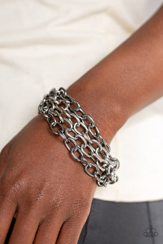 Four strands of bold gunmetal and silver chain layer across the wrist for an edgy look. Features an adjustable clasp closure.  Sold as one individual bracelet.  Always nickel and lead free.