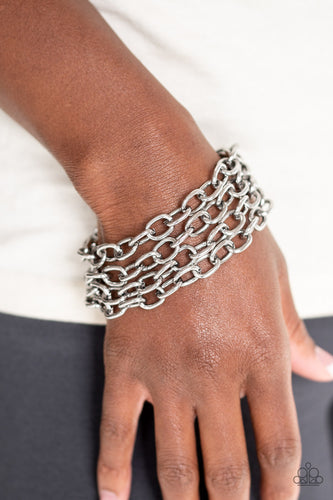 Four strands of bold silver chain layer across the wrist for an edgy look. Features an adjustable clasp closure.  Sold as one individual bracelet.  Always nickel and lead free.