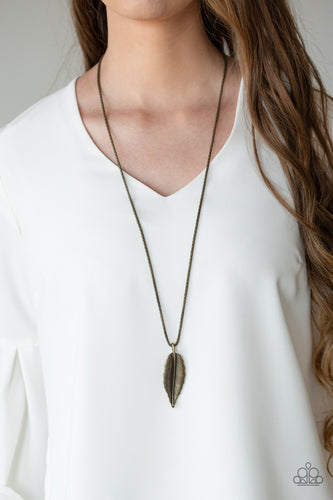 Featuring lifelike textures, a glistening brass feather pendant swings from the bottom of a lengthened brass popcorn chain for a seasonal look. Features an adjustable clasp closure.  Sold as one individual necklace. Includes one pair of matching earrings.  Always nickel and lead free.