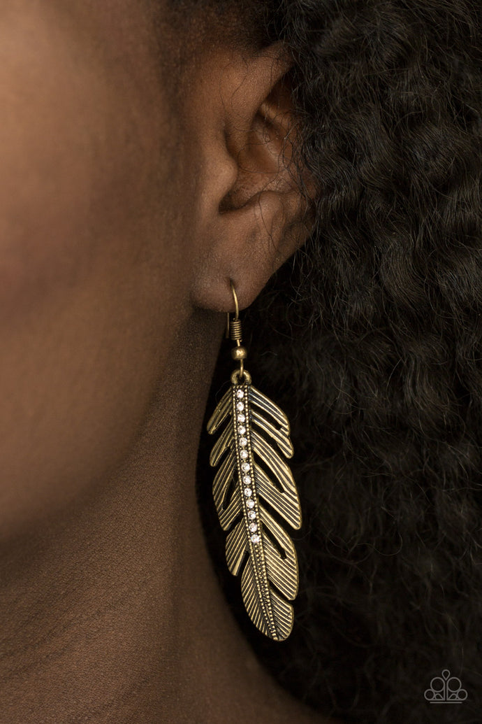 Glassy white rhinestones are encrusted along the spine of a refined brass feather, creating a seasonal lure. Earring attaches to a standard fishhook fitting.  Sold as one pair of earrings.  Always nickel and lead free.