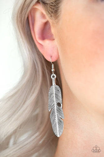 Brushed in an antiqued shimmer, a lifelike silver feather frame swings from the ear in a seasonal fashion. Earring attaches to a standard fishhook fitting.  Sold as one pair of earrings.  Always nickel and lead free.