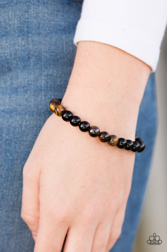 Smooth black and tiger's eye stone accents are threaded along an elastic stretchy band for an earthy look.  Sold as one individual bracelet.  Always nickel and lead free.