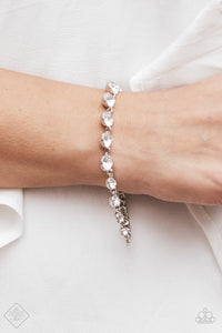 Gradually increasing in size towards the center, glittery white rhinestones link across the wrist for a timeless look. Features an adjustable clasp closure.  Sold as one individual bracelet.    Fiercely 5th Avenue Fashion Fix May 2018  . Always nickel and lead free.