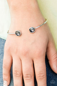 Attached to a curling silver bar, square smoky rhinestones are pressed into silver fittings, creating a dainty cuff.  Sold as one individual bracelet.