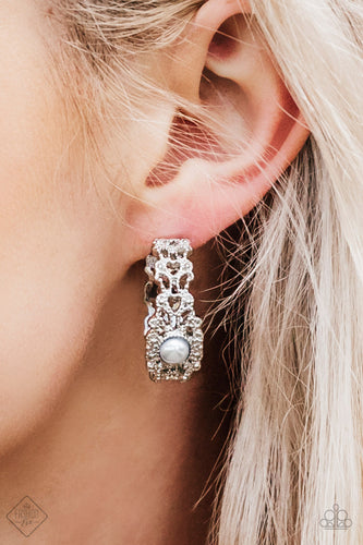 Dotted in shimmery silver textures, a frilly filigree hoop swings from the ear in a refined fashion. A pearly silver bead adorns the center of the hoop for a glamorous finish. Earring attaches to a standard post fitting. Hoop measures 1