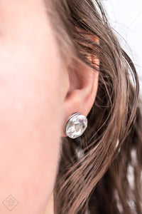 A sparkling white rhinestone is nestled inside a round silver frame for a timeless look. Earring attaches to a standard post fitting.  Sold as one pair of post earrings.   Fiercely 5th Avenue May 2018  Always nickel and lead free.