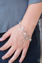 Load image into Gallery viewer, Asymmetrical silver hoops connect with pearly white beads across the wrist for a refined look. Features an adjustable clasp closure.  Sold as one individual bracelet.  Always nickel and lead free.