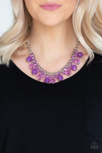 A collection of glassy and opaque purple crystal-like beads swing from the bottom of interlocking silver chains, creating a fabulous fringe below the collar. Features an adjustable clasp closure.  Sold as one individual necklace. Includes one pair of matching earrings. Always nickel and lead free.