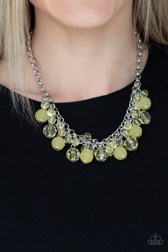 A collection of glassy and opaque yellow crystal-like beads swing from the bottom of interlocking silver chains, creating a fabulous fringe below the collar. Features an adjustable clasp closure.  Sold as one individual necklace. Includes one pair of matching earrings. Always nickel and lead free.