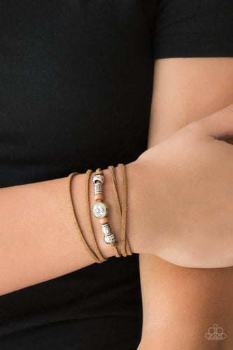 An array of brown and silver beads are knotted in place along elongated suede cording for a wanderlust fashion. To secure bracelet, tie ends in place around the wrist at desired length.  Sold as one individual bracelet.  Always nickel and lead free.