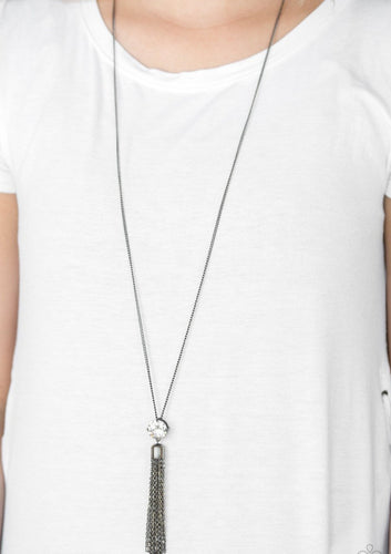 Infused with an elegantly elongated gunmetal chain, a dramatic white gem gives way to a shimmery gunmetal chain tassel for a glamorous look. Features an adjustable clasp closure.  Sold as one individual necklace. Includes one pair of matching earrings.  Always nickel and lead free.