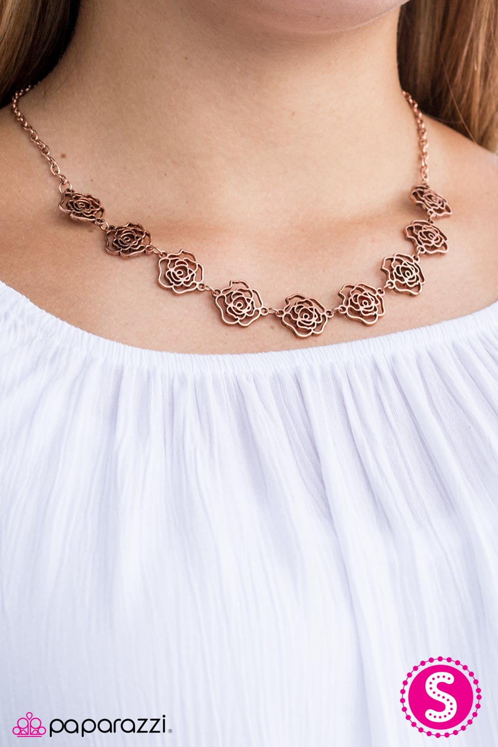 Brushed in a shiny copper finish, stenciled rosebuds link below the collar in a vintage inspired fashion. Features an adjustable snap closure.  Sold as one individual necklace. Includes one pair of matching earrings. Always nickel and lead free.
